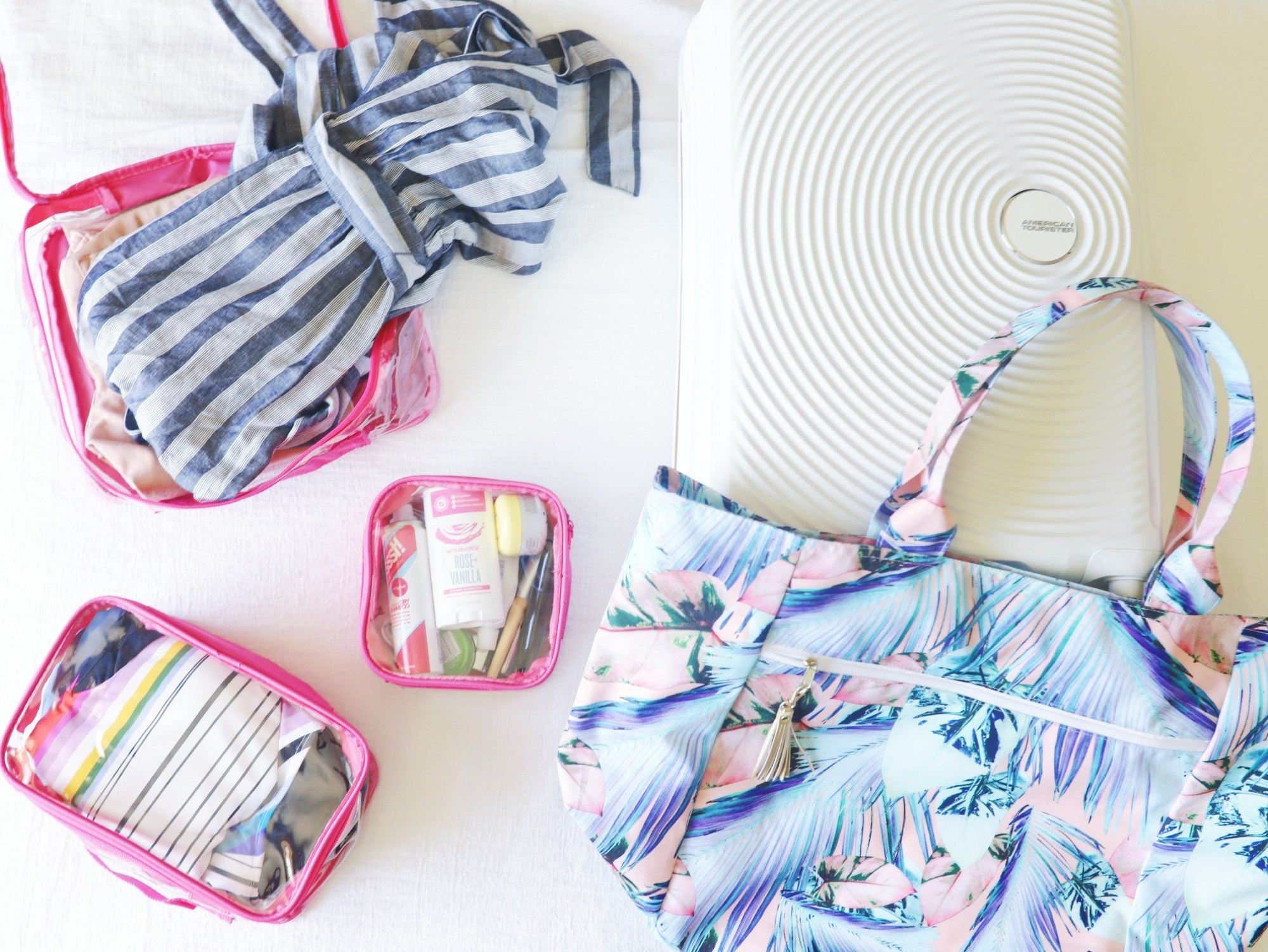 Organized summer tote bag with clear packing cubes