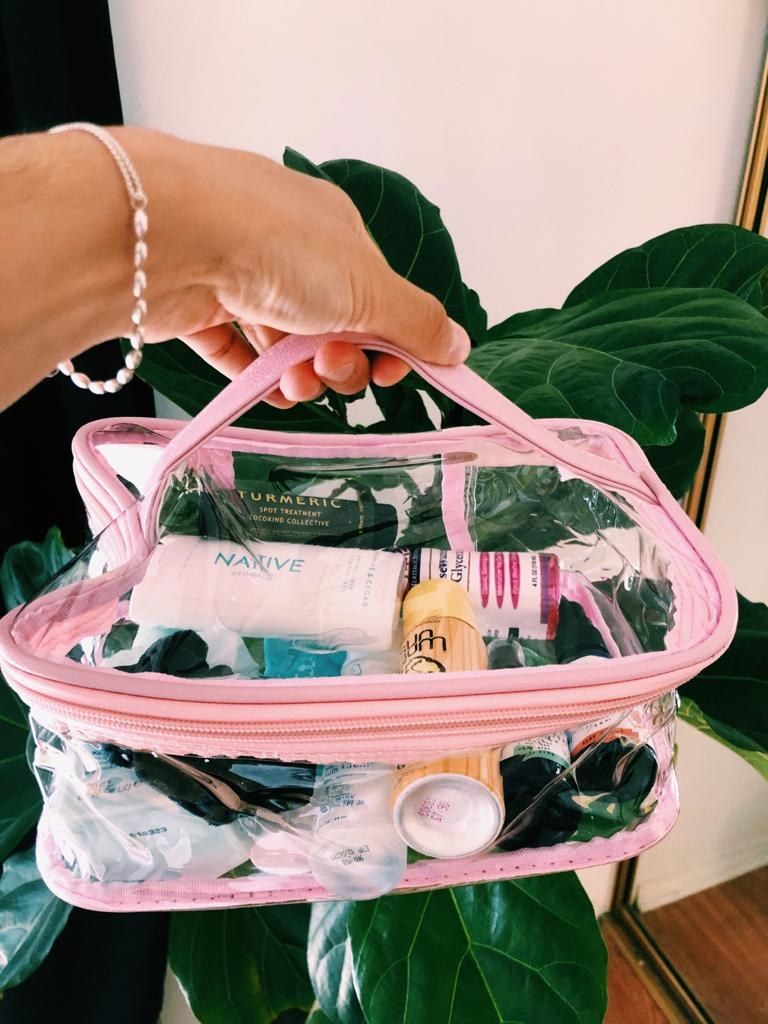 Woman holding a clear cosmetic bag