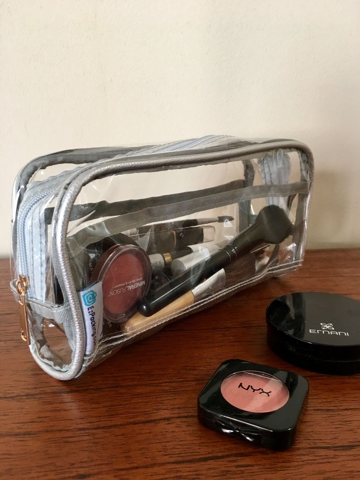 cosmetics in a clear makeup pouch