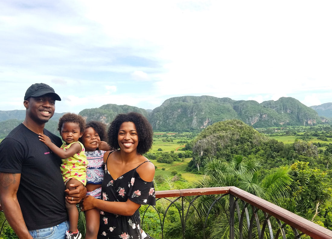 Monet Hambrick with daughters and husband traveling