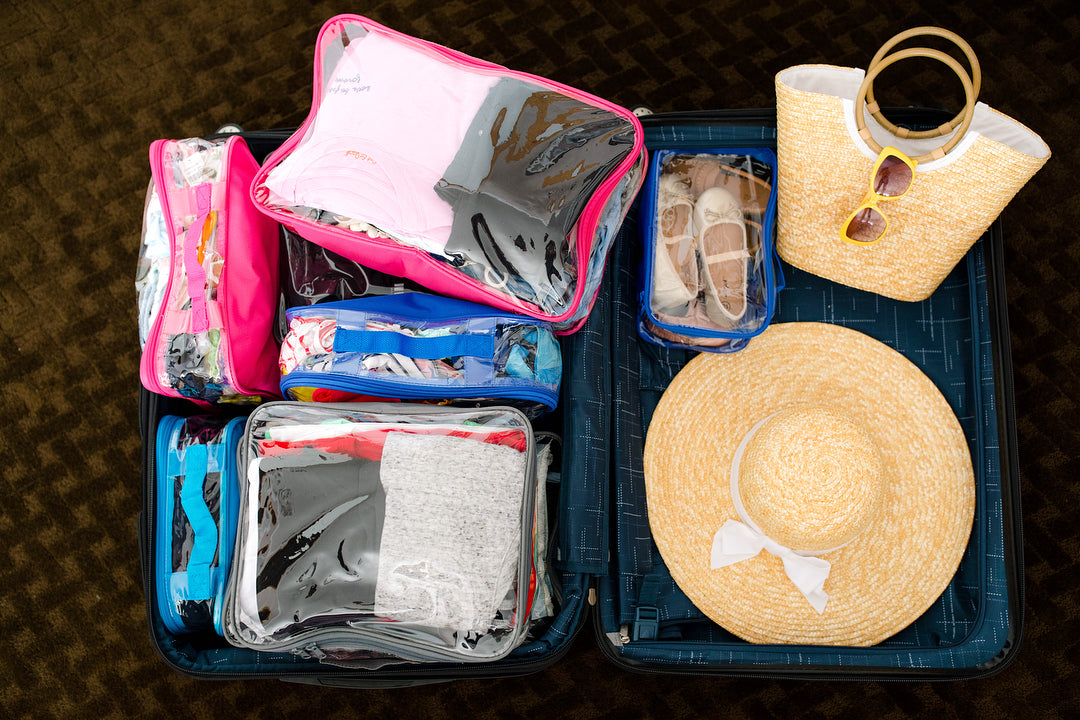 family vacation essentials packed in a suitcase with packing cubes