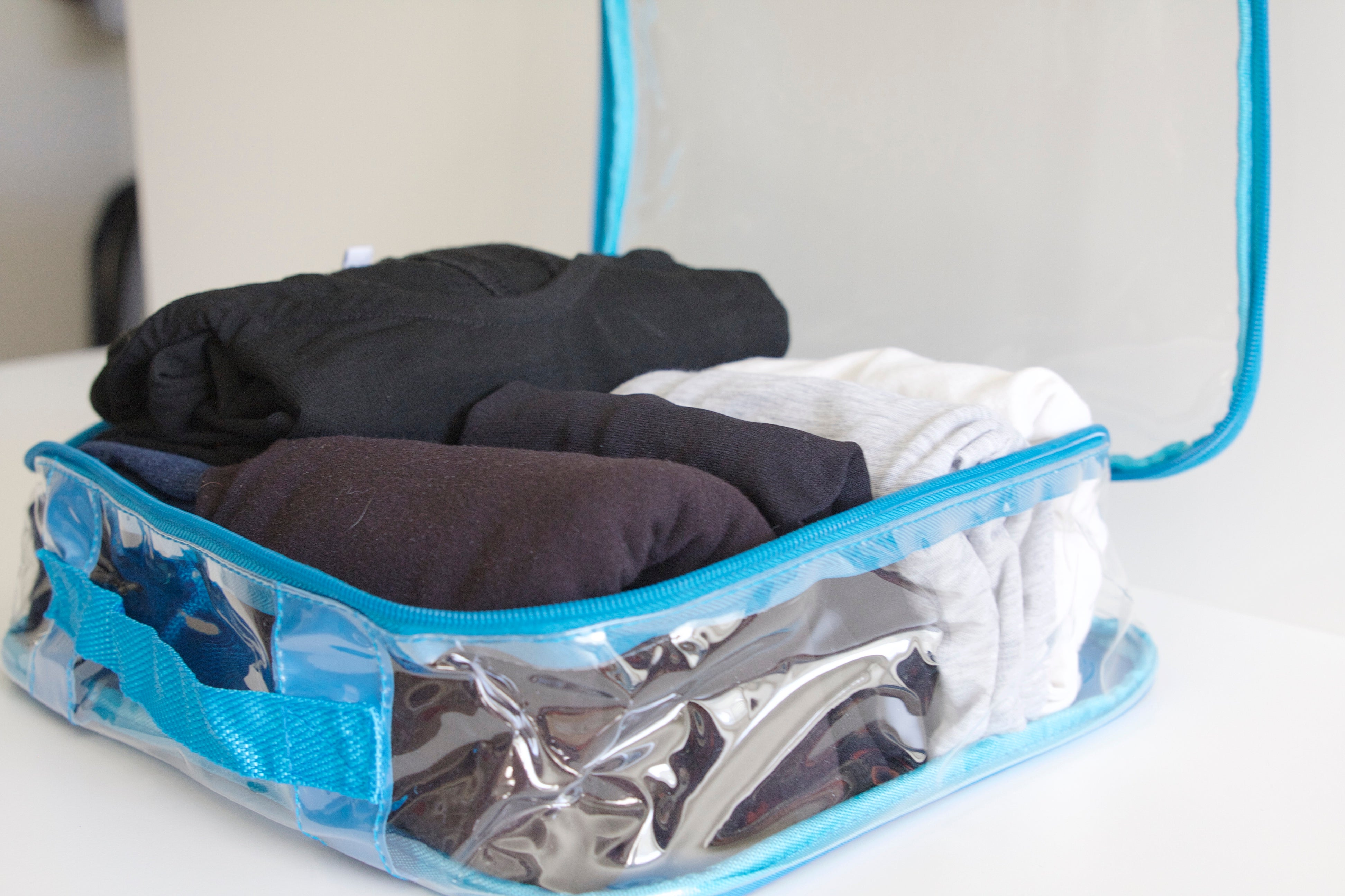 Folded clothes in a clear cube