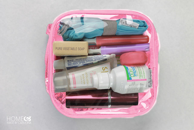 Toiletries in a pink extra small cube