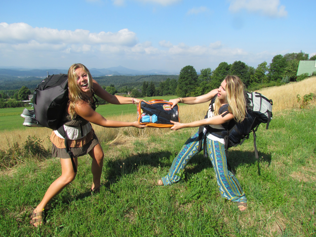 Girls fighting over packing cube with complete hiking necessities