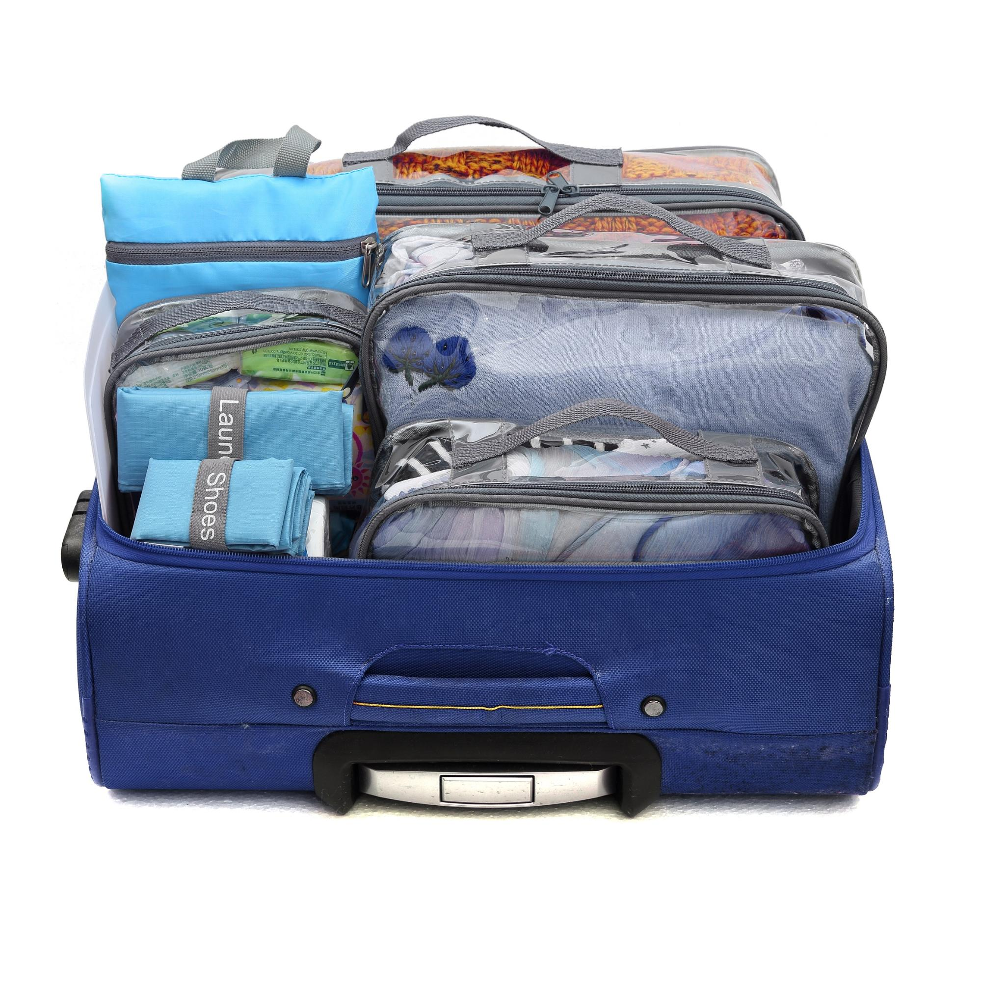 Grey EzPacking cubes inside blue suitcase you can use for completing your international travel checklist
