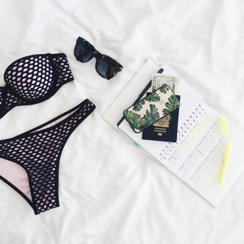 Bikini, smartphone, passport and money for essentials in packing list for a month