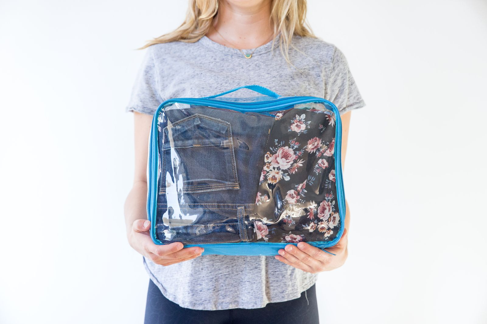 Jeans packed in turquoise clear packing cube