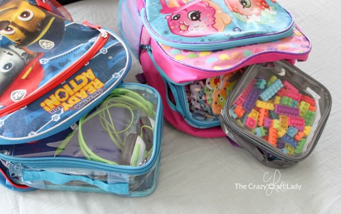 Kids toys, electronics and other travel items organized in packing cubes for backpacking