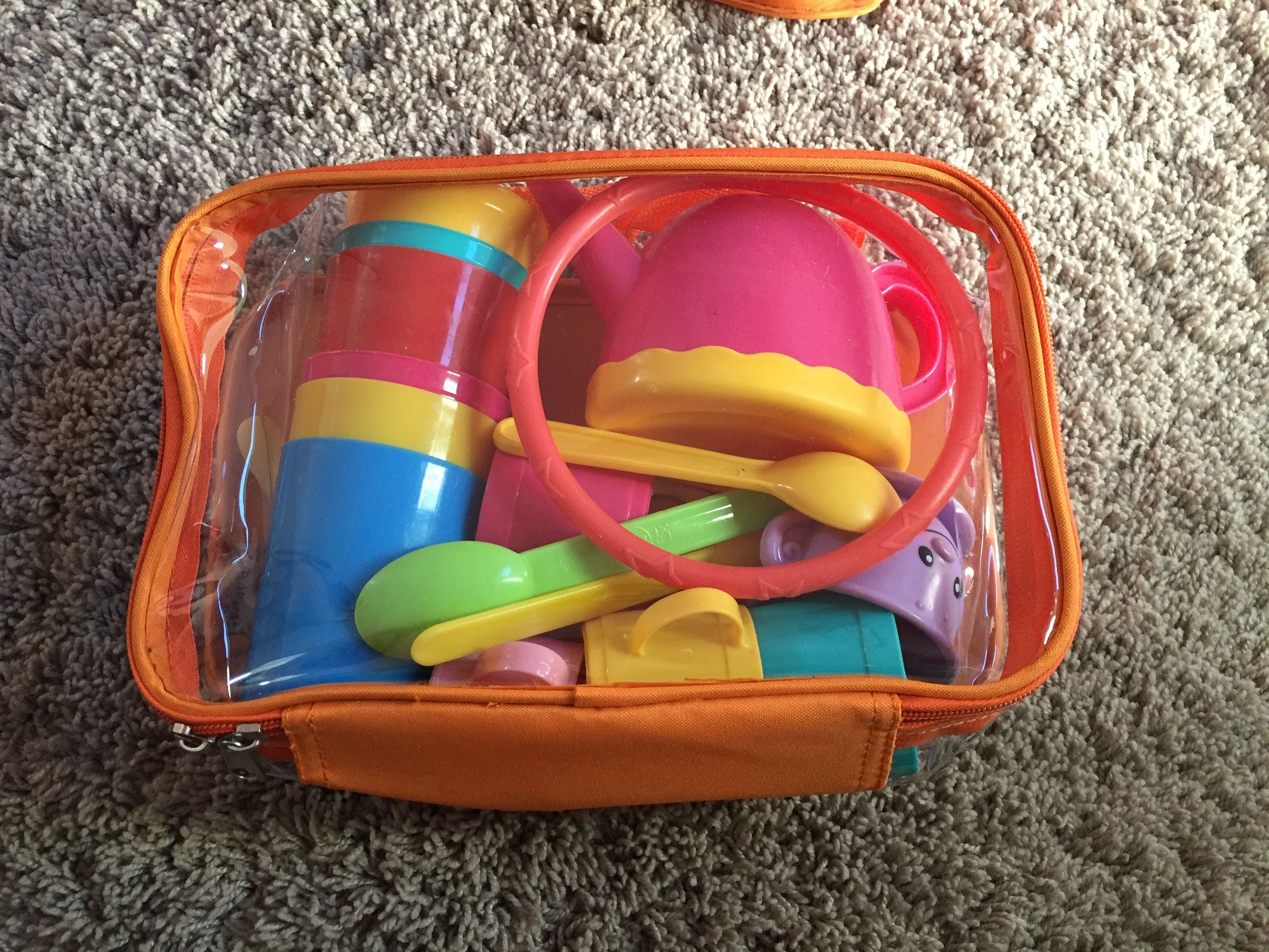 kids toys organized in a small orange cube