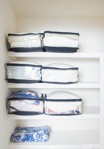 linen closet organization with packing cubes