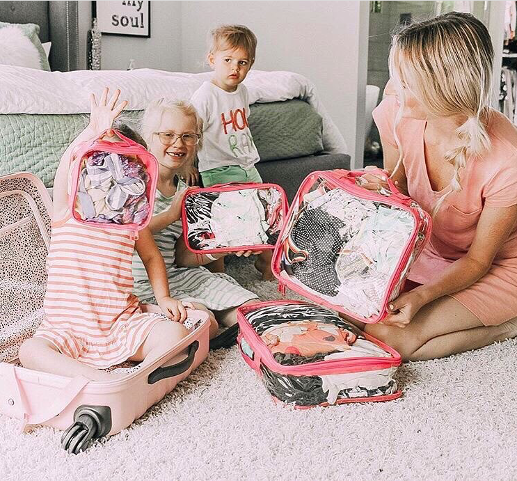 mom and kids packing for travel in a rose starter set