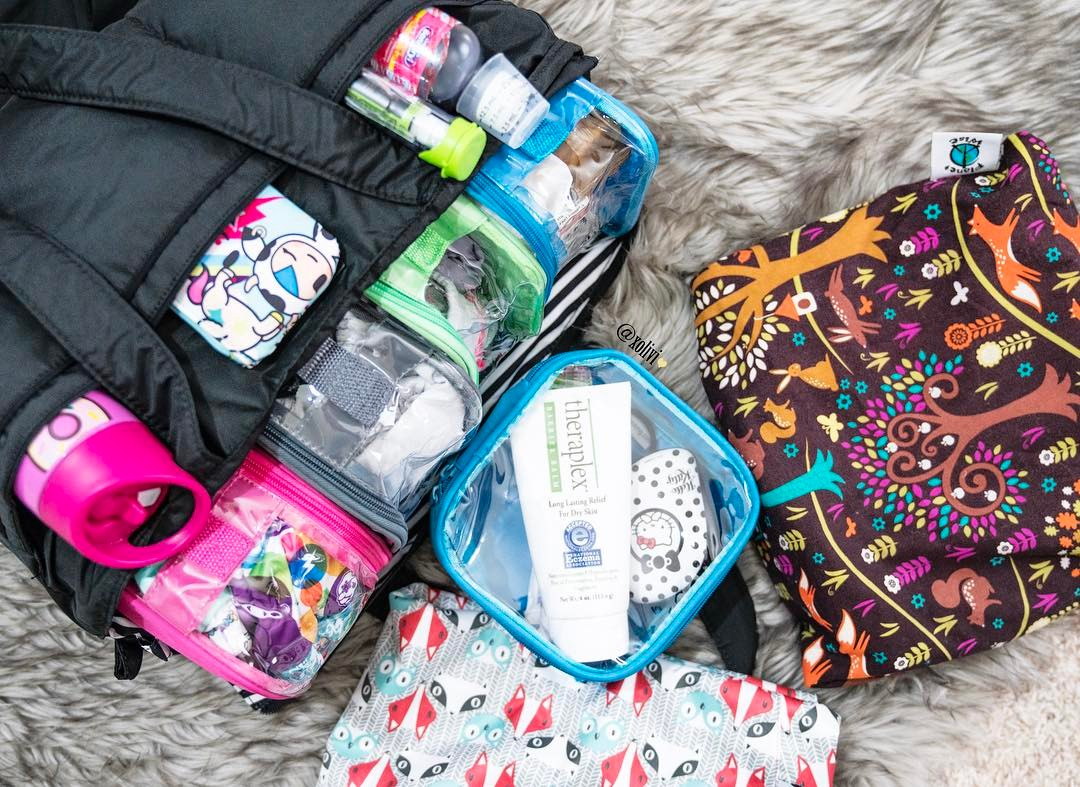 diaper bag organized using clear packing cubes