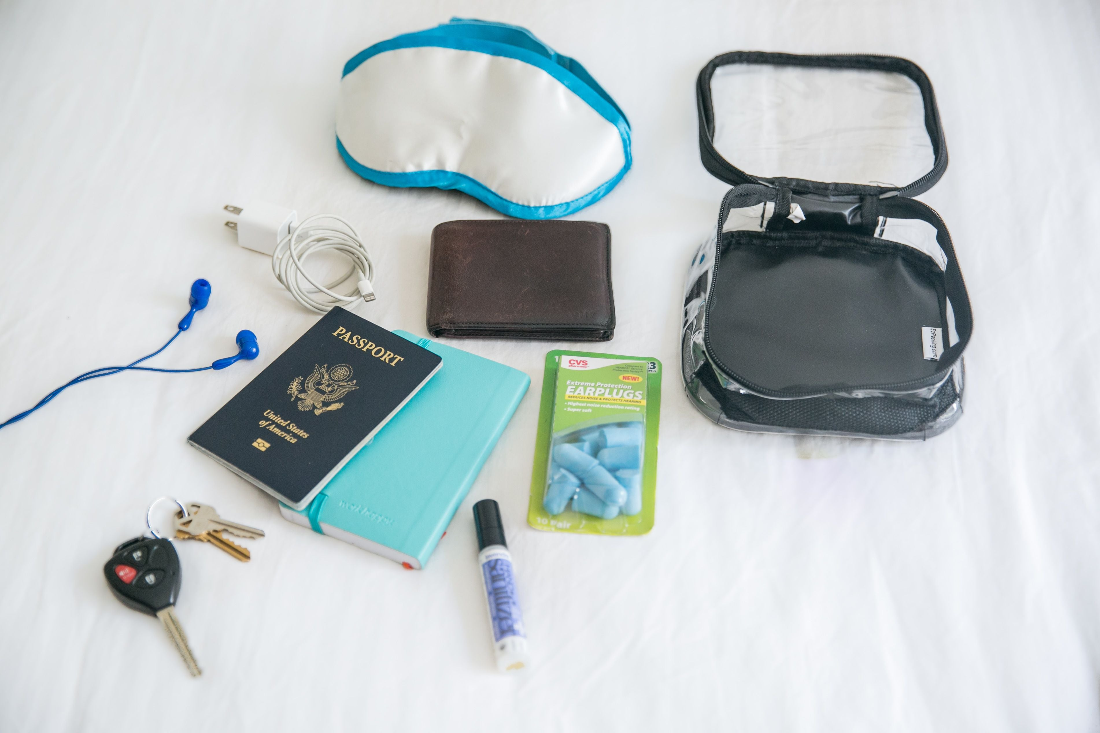 passport and other travel essentials in an extra small cube
