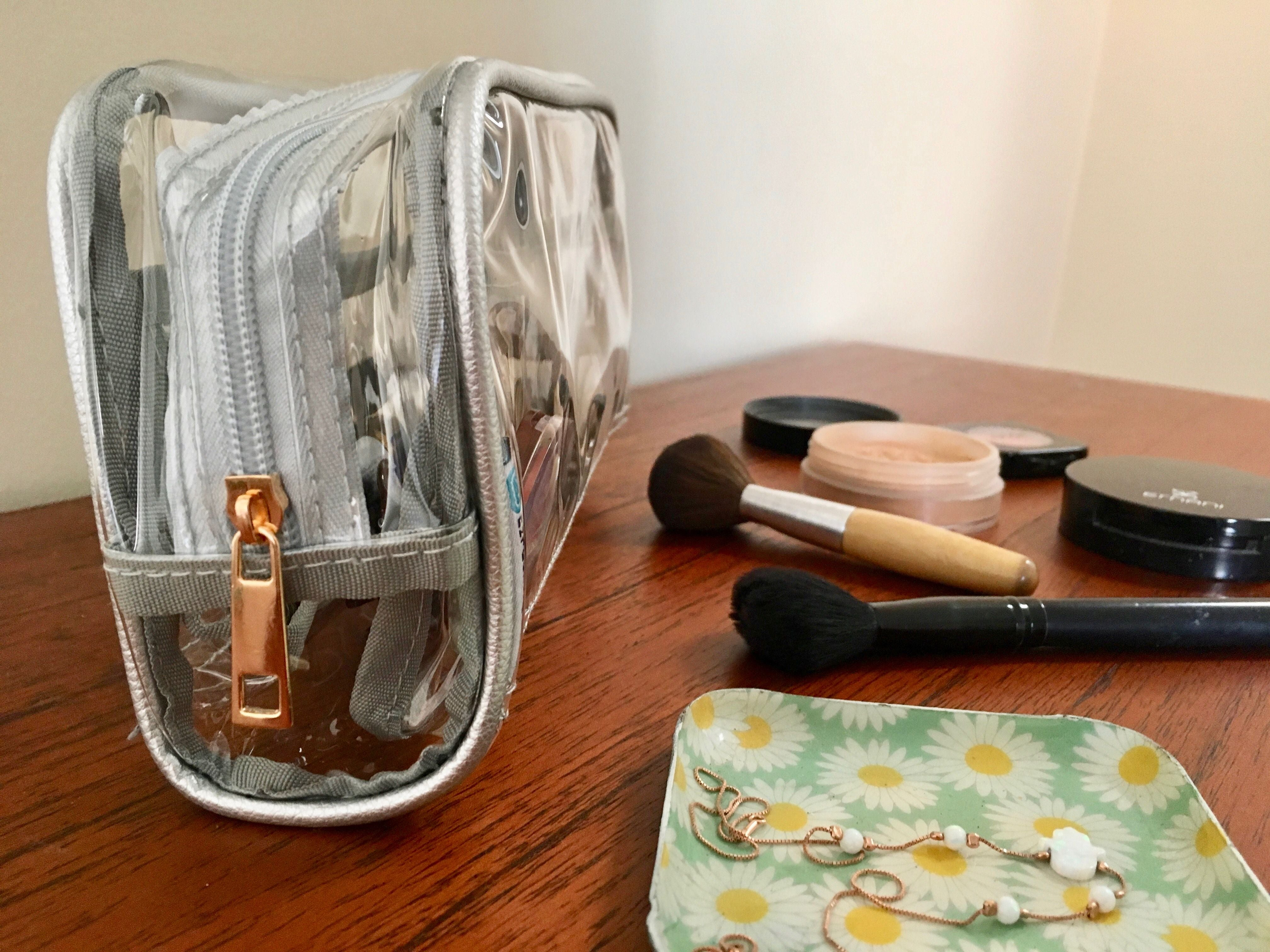 Clear makeup bag and tools on the table