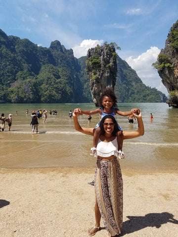 Monet Hambrick and daughter in beach in Phuket, Thailand