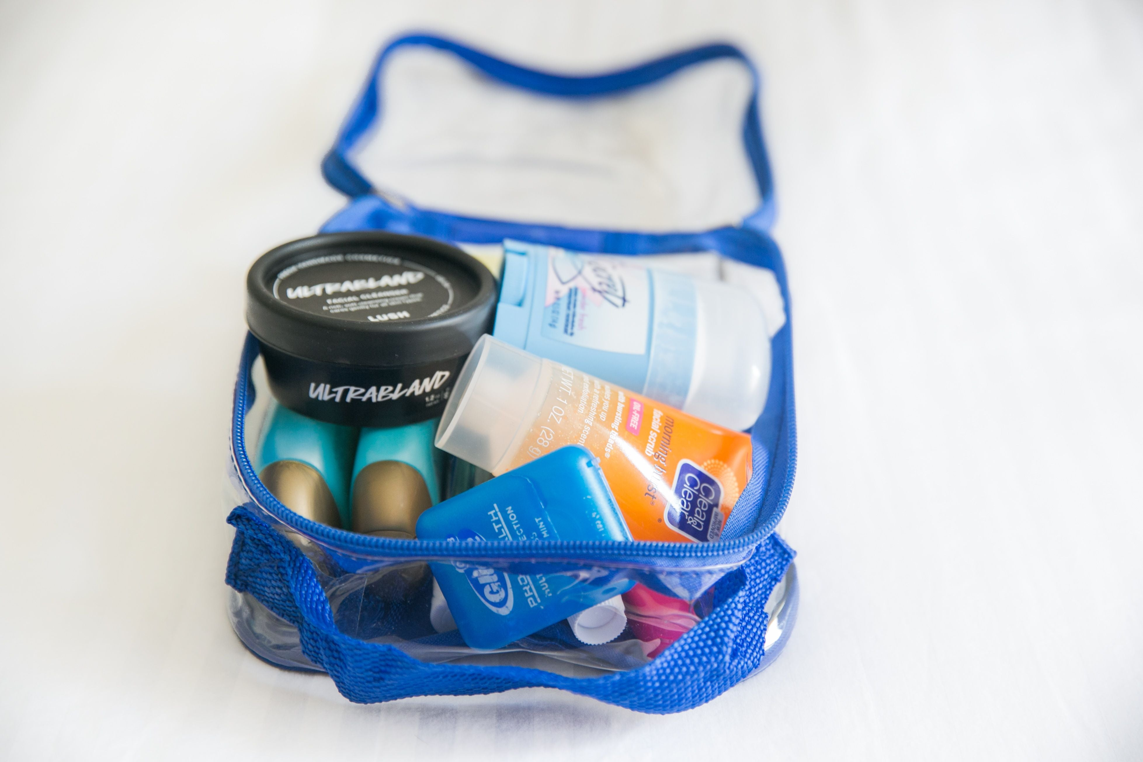 toiletries in a royal blue extra small cube