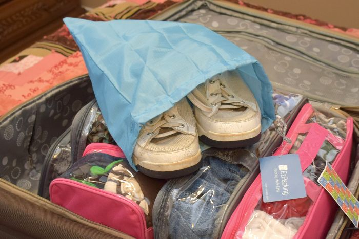 white sneakers in a travel shoe bag