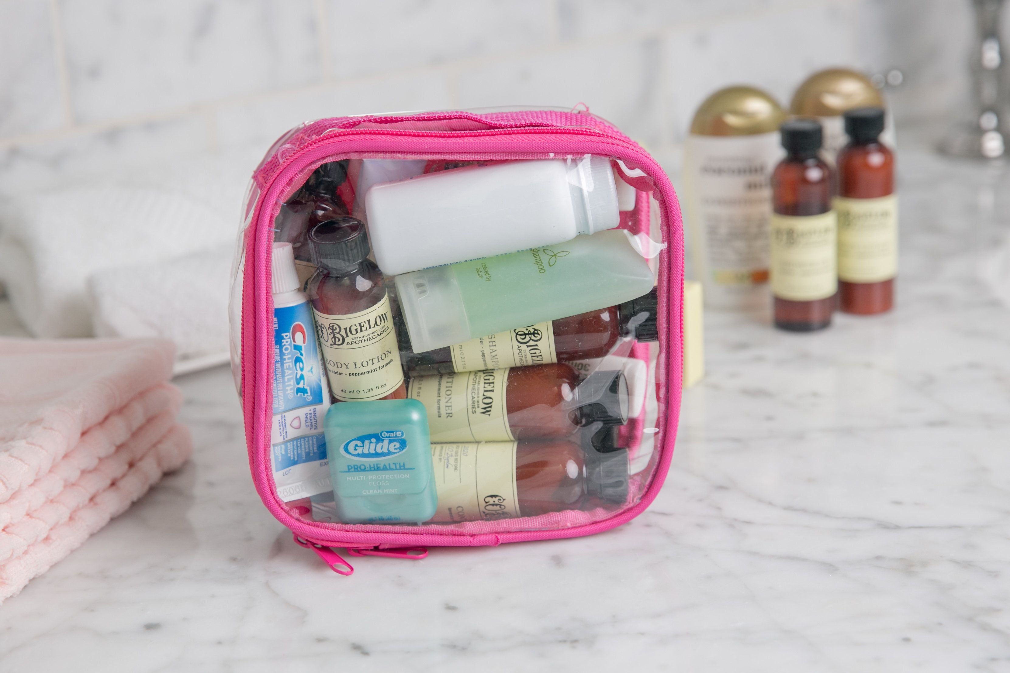 Bathroom toiletries in a pink extra small cube