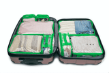 Luggage organizer set in green inside luggage