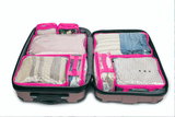 Pink clear packing cube set inside suitcase