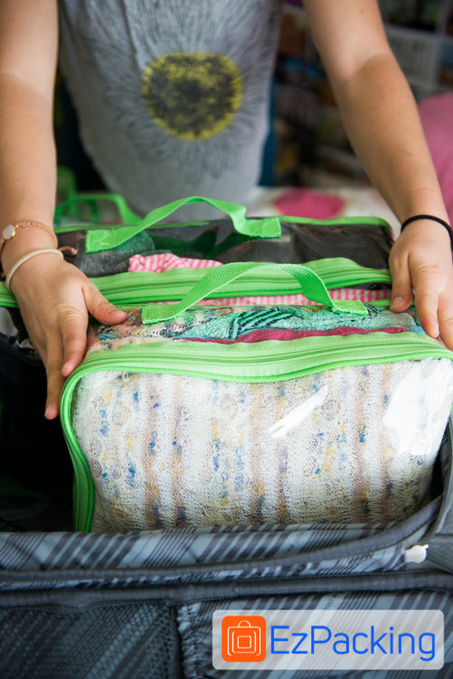 Place EzPacking Cubes vertically in a suitcase to maximize space.