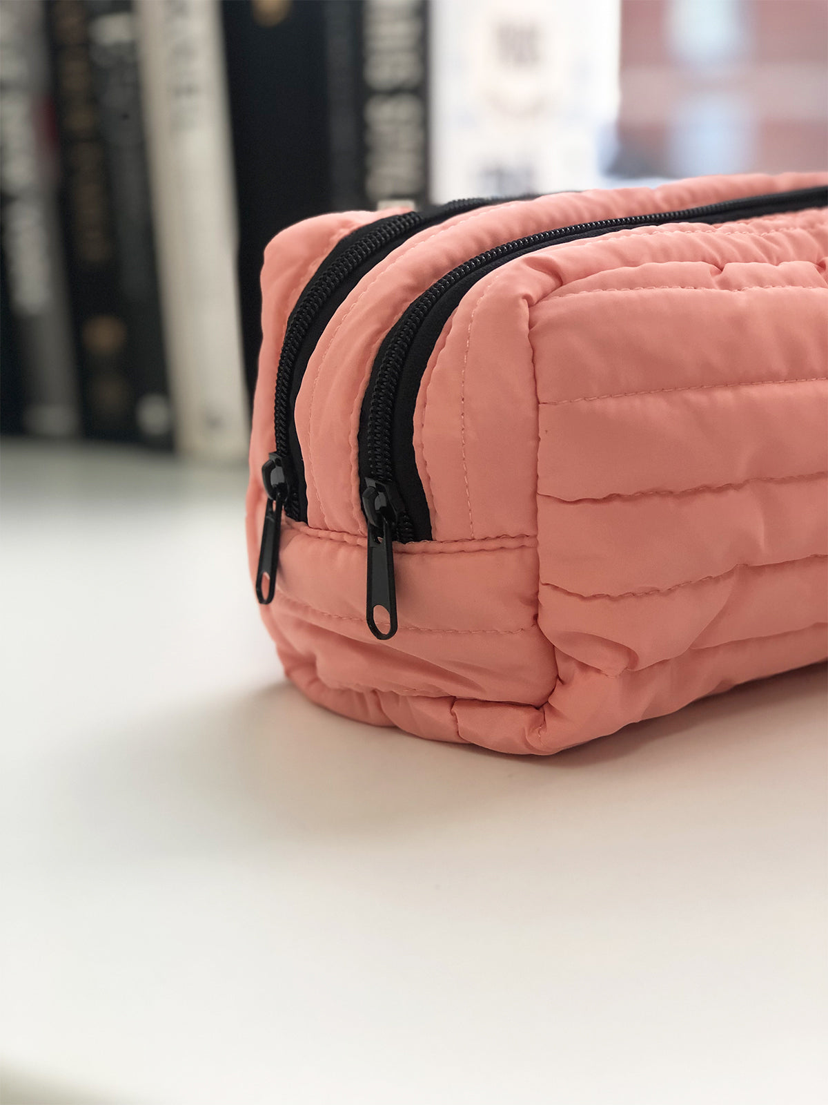 BACKSTAGE PASS PUFFER CLUTCH IN PINK PEACH