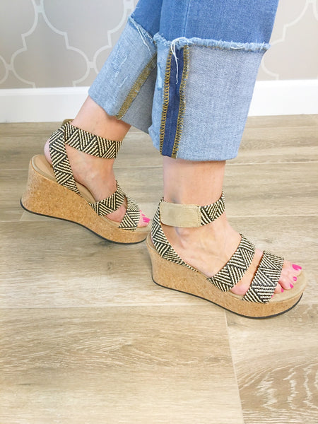 Sole Searching Raffia Wrapped Wedge Sandal