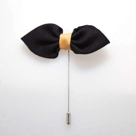 BLACK AND GOLD BOW TIE LAPEL PIN