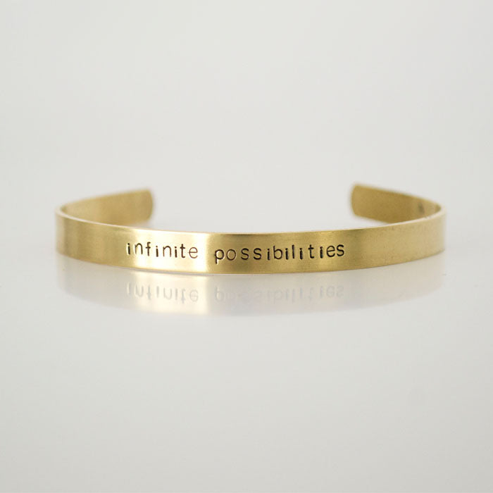 Grey Theory Mill - infinite possibilities, stamped brass cuff