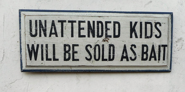 """Unattended Kids"" sign"