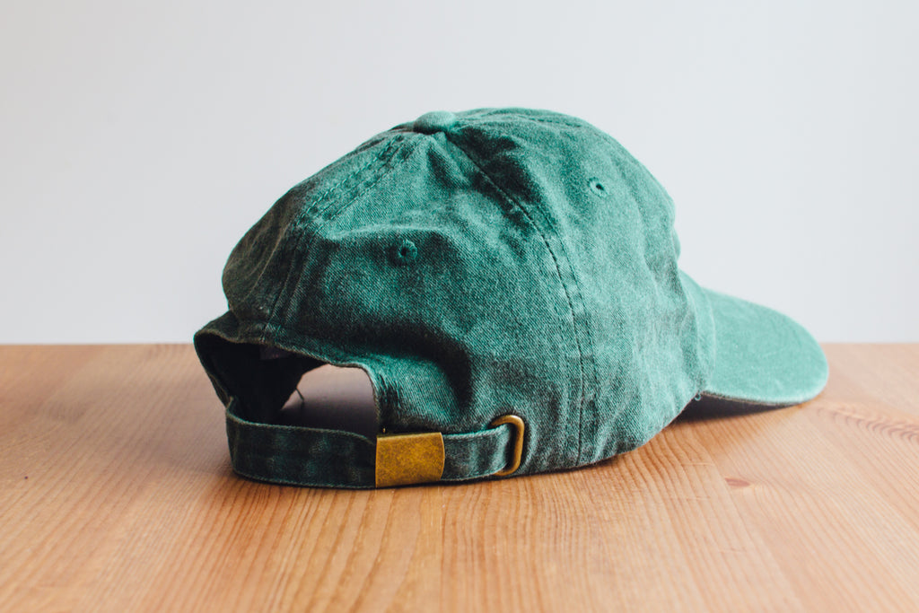 Nailed to the X Dad Hat in Forest Green