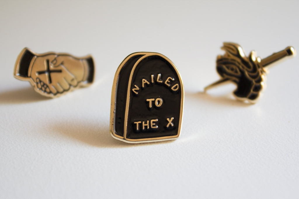 Nailed To The X Lapel Pin