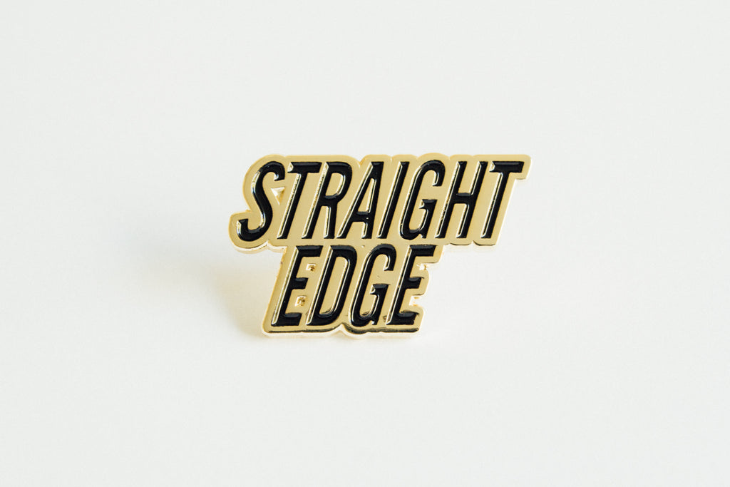 Straight Edge Lapel Pin in black and gold by STRAIGHTEDGEWORLDWIDE