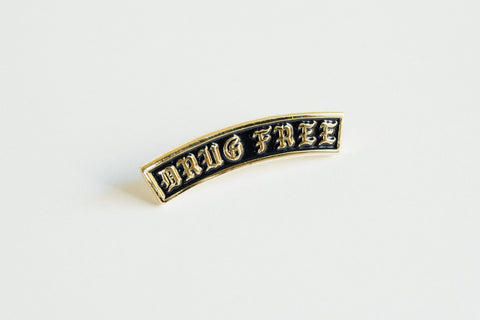 Drug Free Arch Straight Edge Lapel Pin in black and gold by STRAIGHTEDGEWORLDWIDE