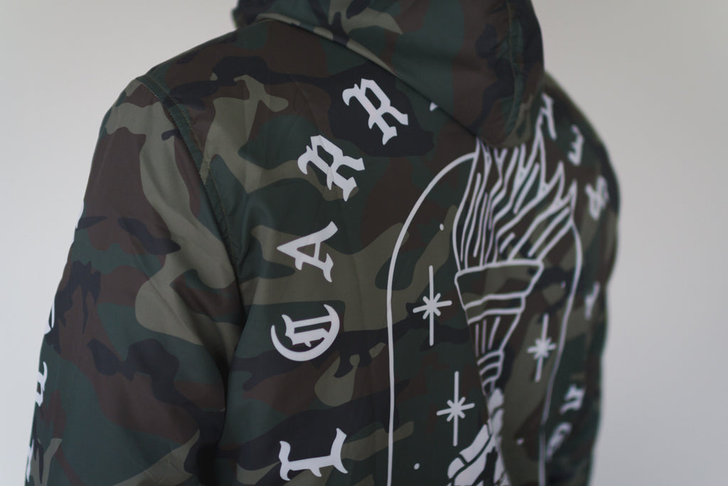 I'll Carry This Torch straight edge windbreaker in camo