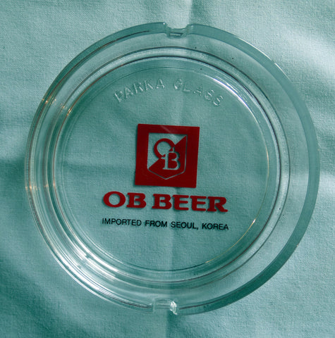 CLEAR GLASS TABLE ASHTRAY – 'OB' KOREAN BEER