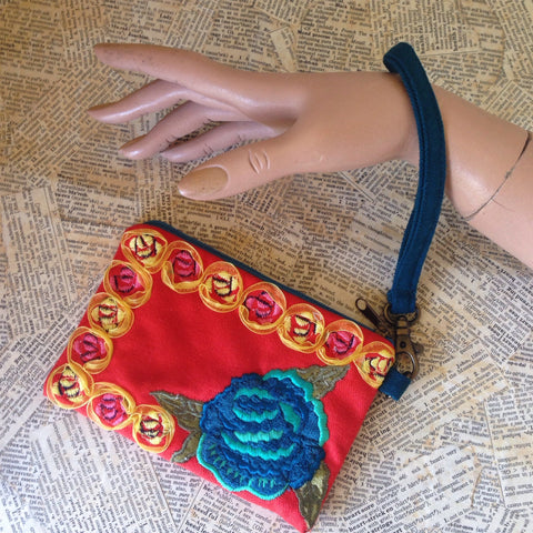 embroidered floral orange wristlet
