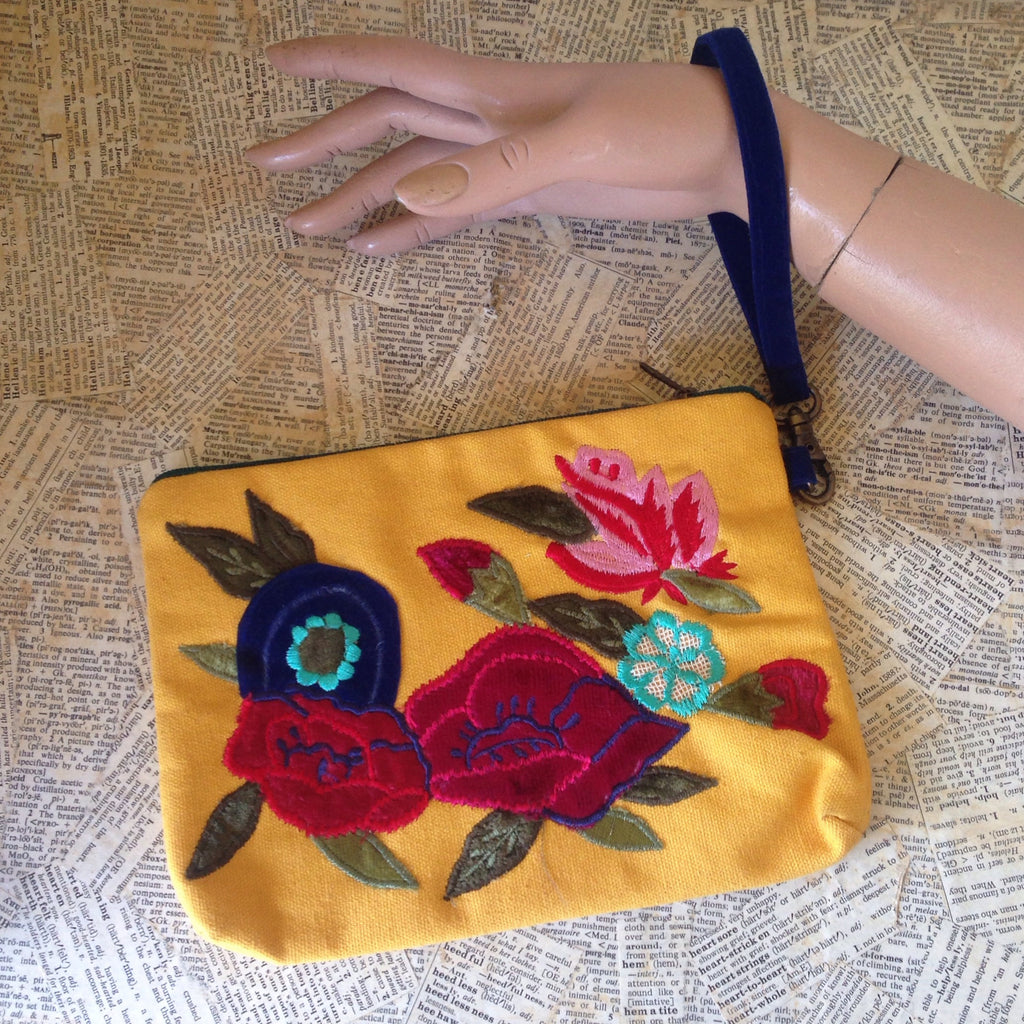 embroidered floral yellow wristlet