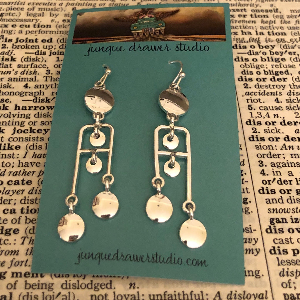 Shiny silver circle patterned earrings