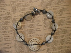 bracelet: ivory buttons/silver beads on linen cord