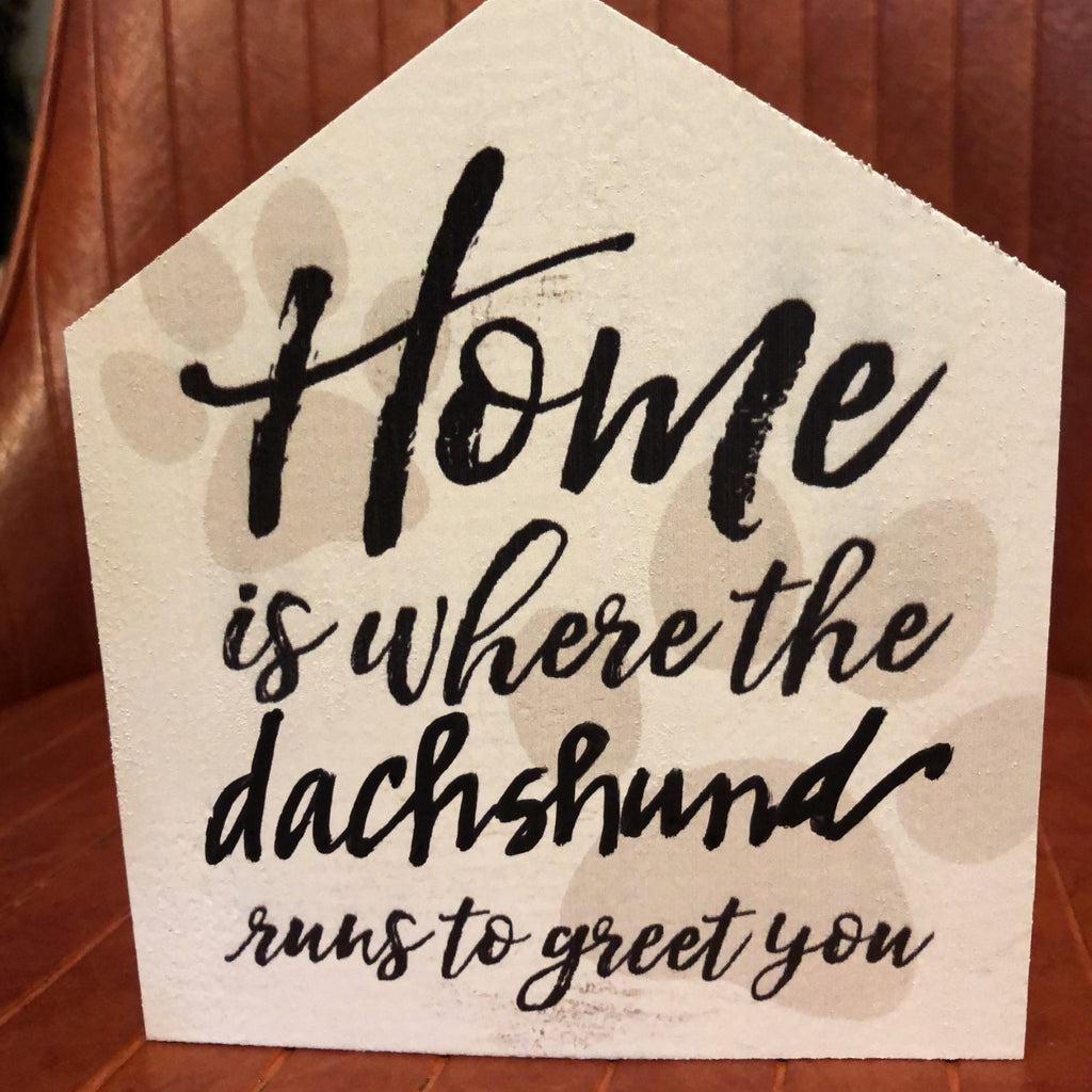Sign: Home is where the....runs to greet you