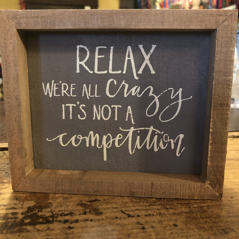 RELAX we are all crazy It's not a competition SIGN