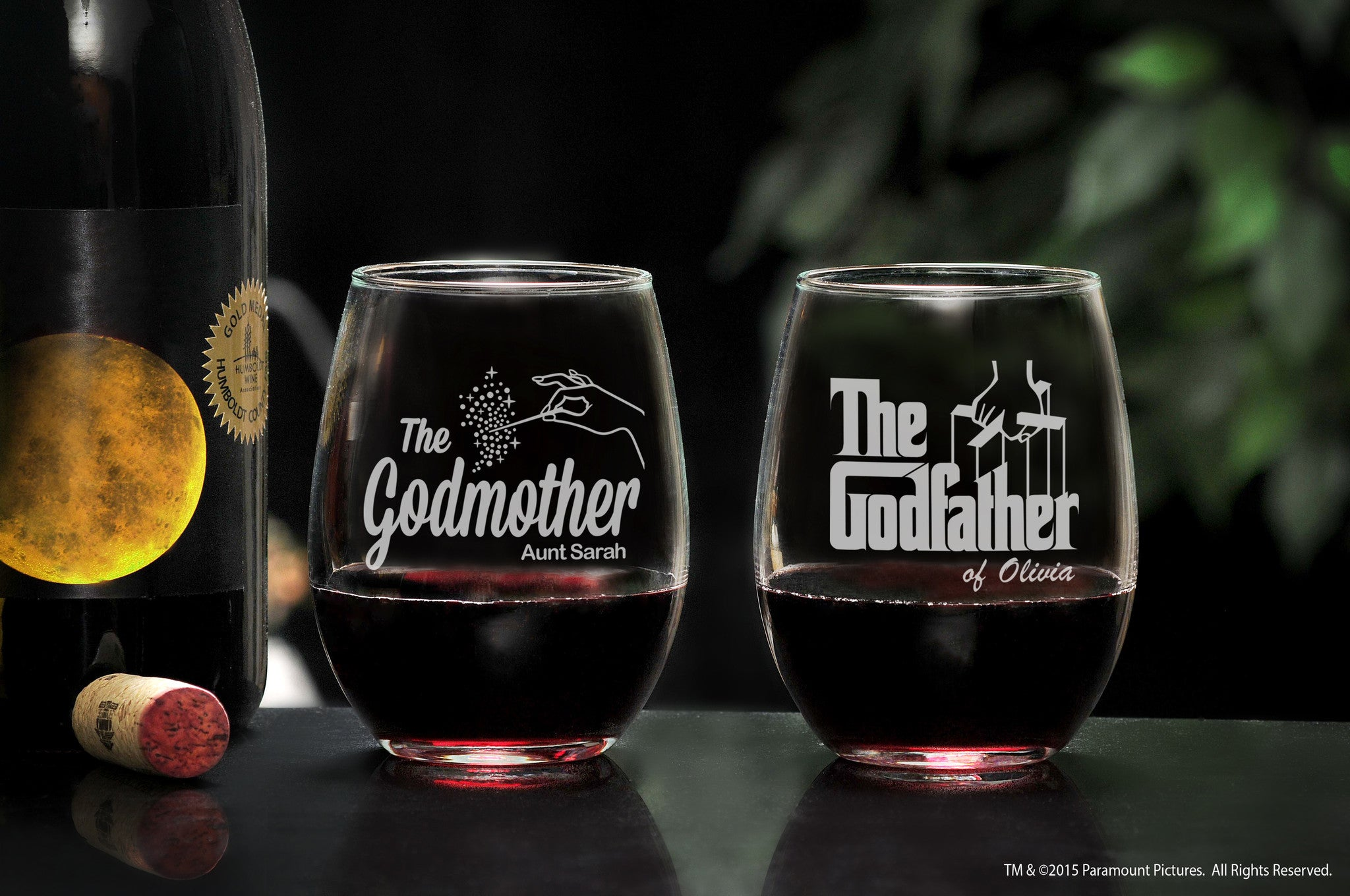 Personalized Stemless Wine Glass Set for Godparents two stemless wine glasses with wine and the godfather movie logo and fairy godmother