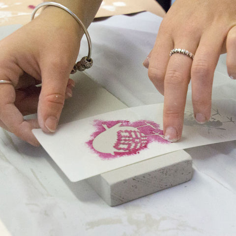 Placing the robin stencil ready to paint, Christmas tree workshop at The Stencil Studio Ltd