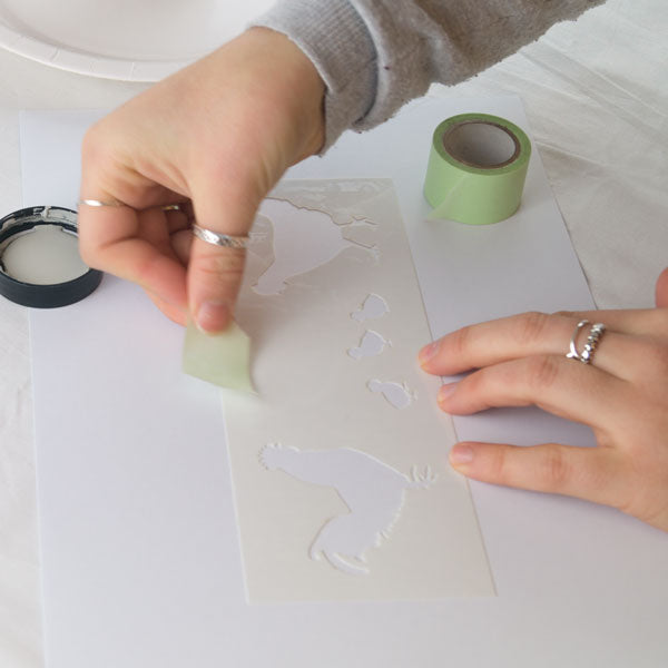 How to stencil tutorial from The Stencil Studio Ltd - sticking the stencil in place