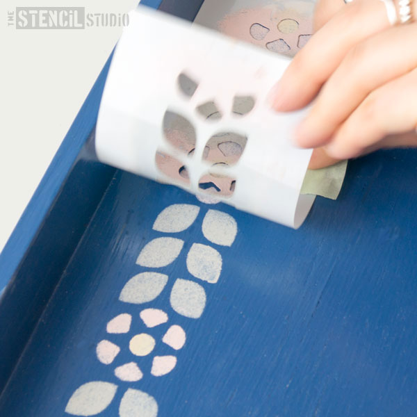 peeling off the stencil mini from the painted tray - tutorials by the stencil studio ltd