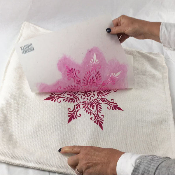 peeling the stencil from the cushion cover. The Stencil Studio Indian Star stencil
