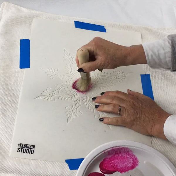 Start stencilling, make sure you don't overload the stencil brush.