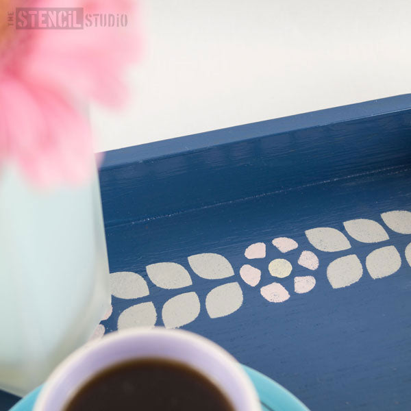 close up of the stencilled tray by the stencil studio Ltd dorit flower border stencil