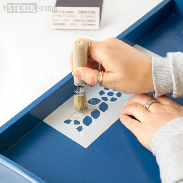 start by stencilling the grey chalk paint onto the stencil, hold firmly in place whilst you paint